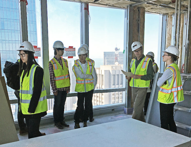 HWI architects and designers tour the 181 Fremont building in San Francisco during construction.